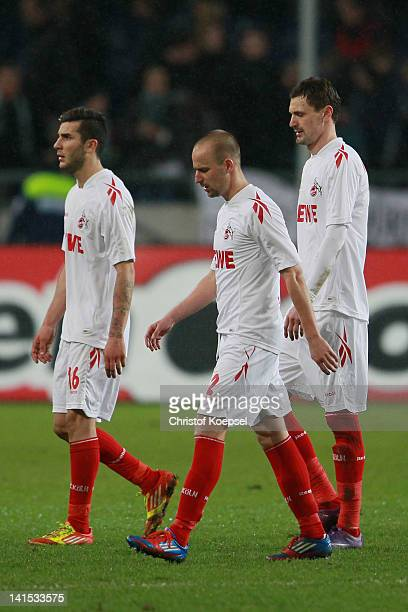 Miaek Ishak Miso Brecko and Milivoje Novakovic of Koeln look dejected after losing 14 the Bundesliga match between Hanover 96 and 1 FC Koeln at AWD...