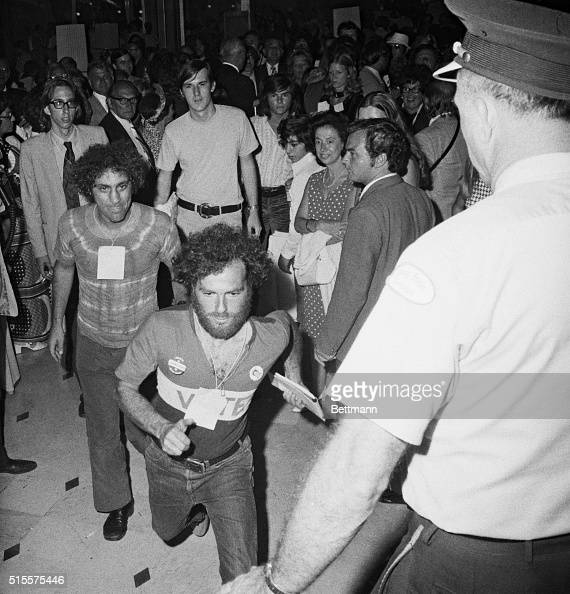 Crashing the scene is Jerry Rubin front and Abbie Hoffman as they dash past guards at the Democratic Telethon Both were wearing passes that permitted...