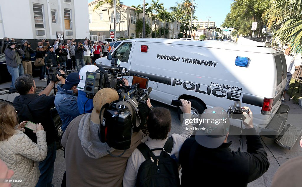 A Miami Beach Police van carrying Justin Bieber leaves the Miami Beach Police station taking him to jail on January 23, 2014 in Miami Beach, Florida. Justin Bieber was charged with drunken driving, resisting arrest and driving without a valid license after Miami Beach Police found the pop star street racing on Thursday morning.