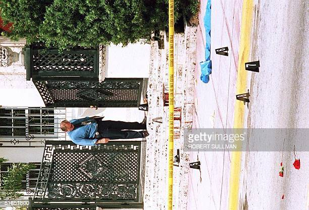 Miami Beach policeman looks at the bloodstained entrance where Italian fashion designer Gianni Versace was shot and killed on Ocean Drive in Miami...