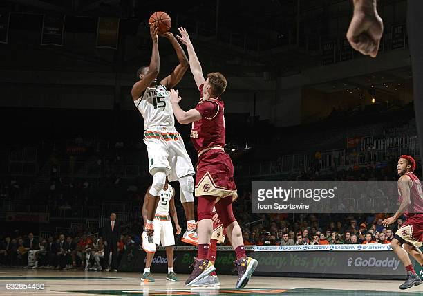 Miami center Ebuka Izundu shoots against Boston College forward Nik Popovic during an NCAA basketball game between the Boston College Eagles and the...
