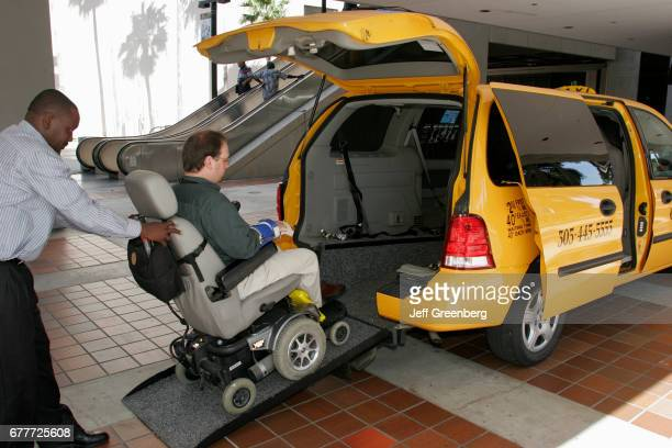 Miami Disability Resource Fair Taxi Driver loading Handicapped man