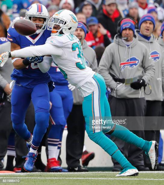 Miami Dolphins cornerback Tony Lippett deflects a pass intended for Buffalo Bills wide receiver Robert Woods in the first quarter at New Era Field in...