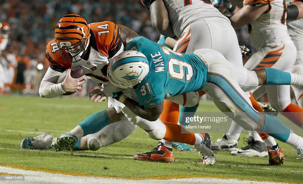 Miami Dolphins defensive end Cameron Wake sacks Cincinnati Bengals quarterback Andy Dalton for a game-winning safety in overtime at Sun Life Stadium in Miami Gardens, Florida, on Thursday, October 31, 2013. The Dolphins won, 22-20.