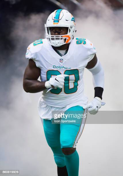 Miami Dolphins Defensive End Charles Harris runs onto the field before the start of an NFL game between the Tennessee Titans and the Miami Dolphins...