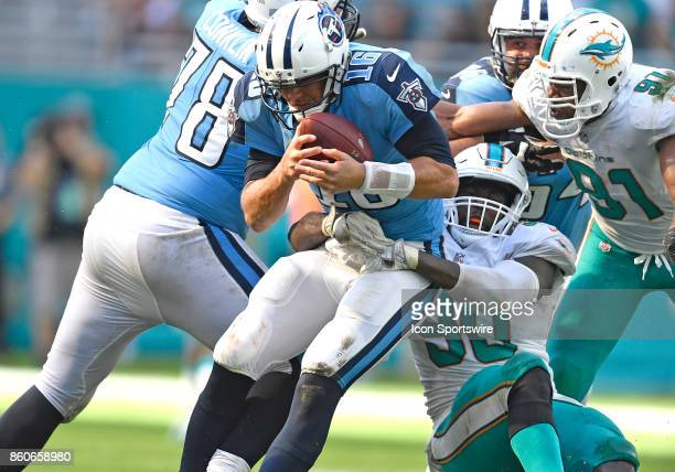 Miami Dolphins defensive end Charles Harris sacks Tennessee quarterback Matt Cassel during an NFL football game between the Tennessee Titans and the...