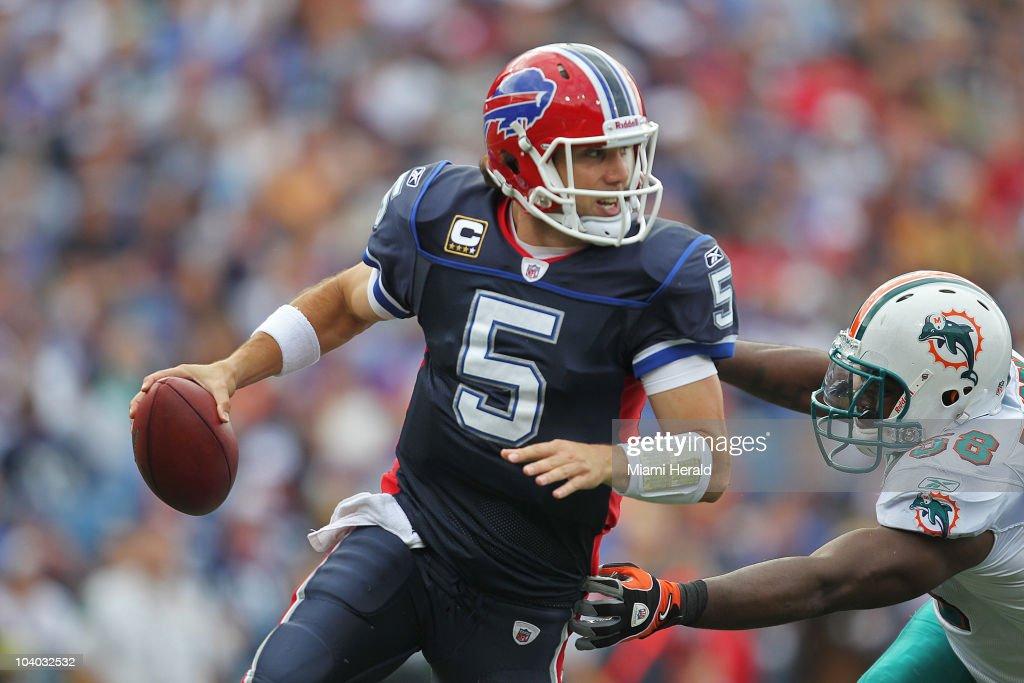 Miami Dolphins defensive end Jared Odrick puts pressure on Buffalo Bills quarterback Trent Edwards in the third quarter at Ralph Wilson Stadium in Buffalo, New York on Sunday, September 12, 2010.