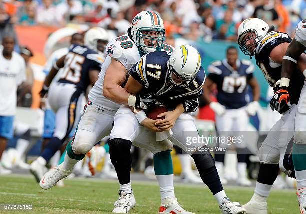 Miami Dolphins defensive end Matt Roth sacks San Diego Chargers quarterback Philip Rivers in the Dolphins' 1710 victory at Dolphin Stadium Miami...