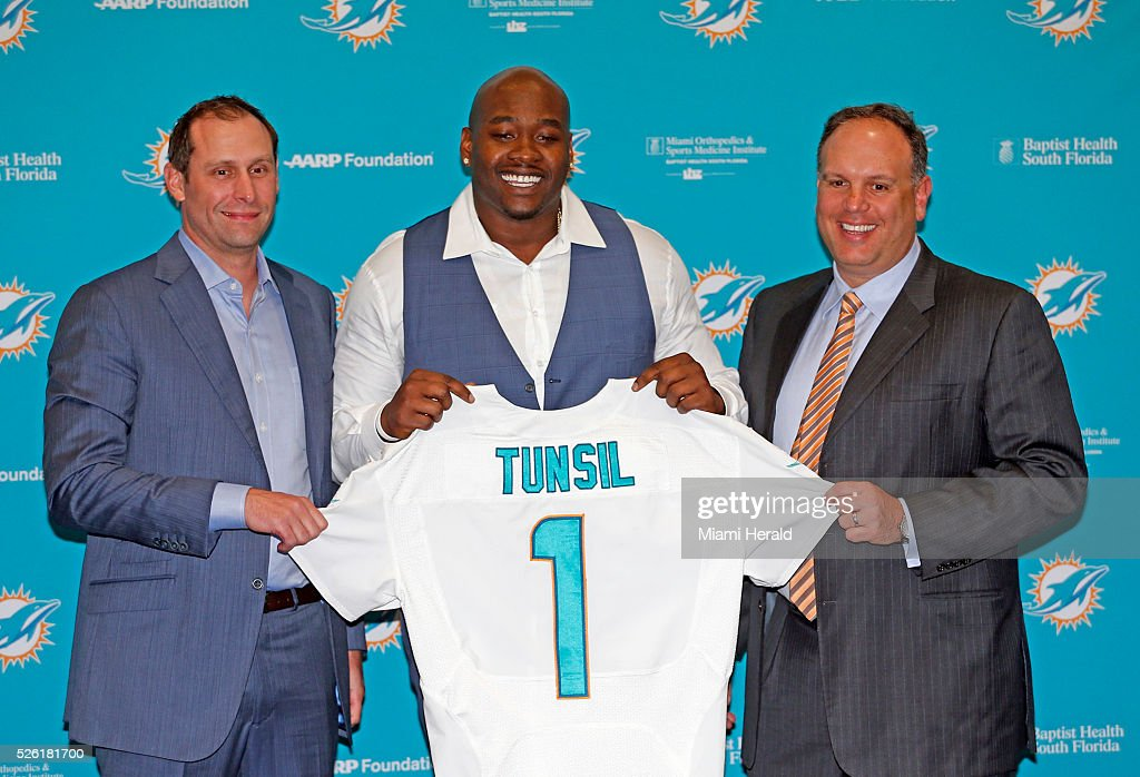 Miami Dolphins head coach Adam Gase and Executive Vice President of Football Operations Mike Tannenbaum with first-round draft pick Laremy Tunsil at the team's training facilty in Davie, Fla., on Friday, April 29, 2016.