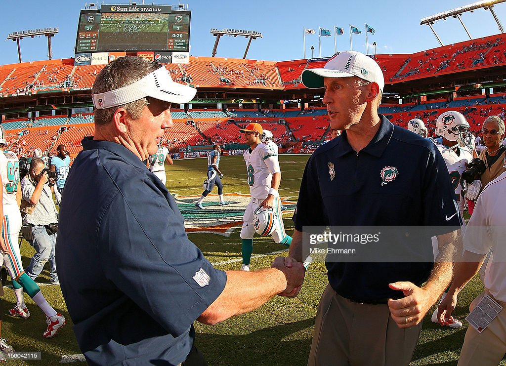 Miami Dolphins head coach <a gi-track='captionPersonalityLinkClicked' href=/galleries/search?phrase=Joe+Philbin&family=editorial&specificpeople=2331822 ng-click='$event.stopPropagation()'>Joe Philbin</a> shakes hands with Tennessee Titans head coach <a gi-track='captionPersonalityLinkClicked' href=/galleries/search?phrase=Mike+Munchak&family=editorial&specificpeople=758157 ng-click='$event.stopPropagation()'>Mike Munchak</a> during a game at Sun Life Stadium on November 11, 2012 in Miami Gardens, Florida.