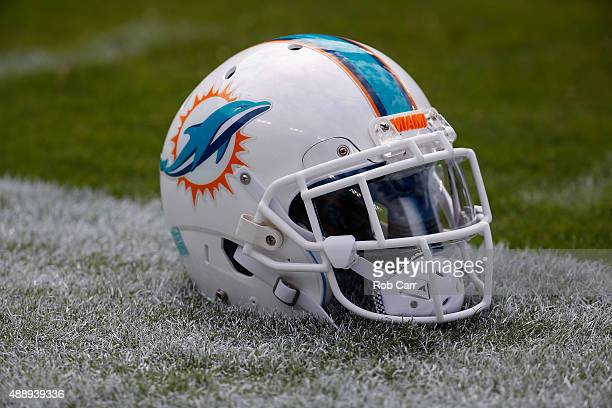 Miami Dolphins helmet sits on the grass before the start of their game against the Washington Redskins at FedExField on September 13 2015 in Landover...