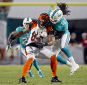 Miami Dolphins linebacker Dannell Ellerbe right breaks up a pass intended for tight end Jermaine Gresham of the Cincinnati Bengals in the first...