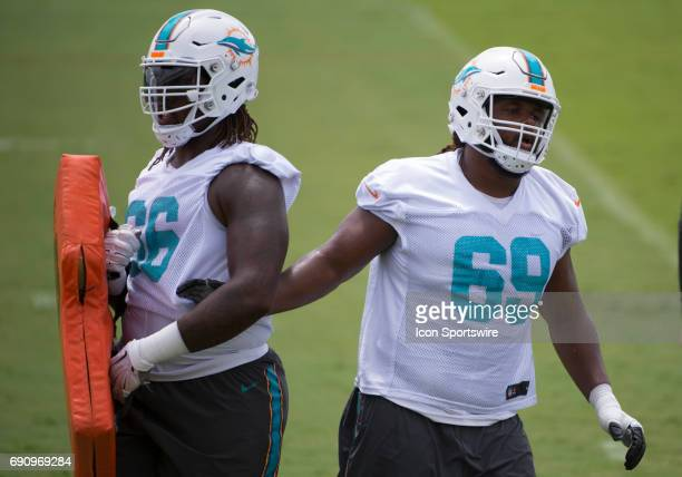 Miami Dolphins Offensive Tackle Avery Young and Miami Dolphins Offensive Tackle Terry Poole run a blocking drill during a practice session at the...