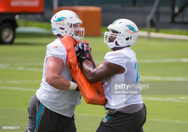 Miami Dolphins Offensive Tackle Jesse Davis and Miami Dolphins Offensive Lineman Jermon Bushrod run a blocking drill during a practice session at the...