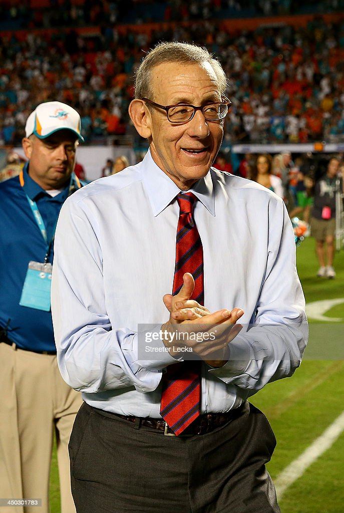Miami Dolphins owner, Stephen Ross, celebrates as he walks off the field after his team defeated the San Diego Chargers 20-16 during their game at Sun Life Stadium on November 17, 2013 in Miami Gardens, Florida.