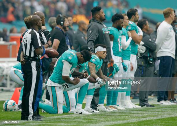 Miami Dolphins players kneel down during the national anthem before the NFL game between the Miami Dolphins and the New Orleans Saints at Wembley...