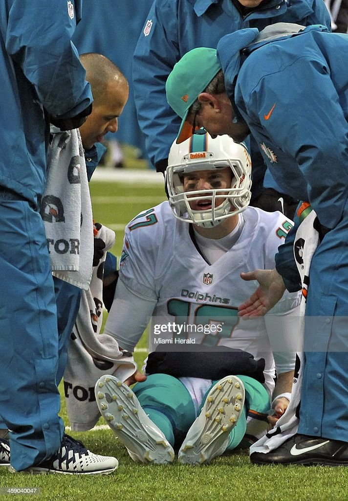 Miami Dolphins quaretrback sits on the field after being sacked by tje Buffalo Bills' Kyle Williams in the fourth quarter at Ralph Wilson Stadium in Buffalo, Sunday, Dec. 22, 2013. Tannehill limped off the field and was replaced by backup quarterback Matt Moore. The Bills defeated the Dolphins, 19-0.