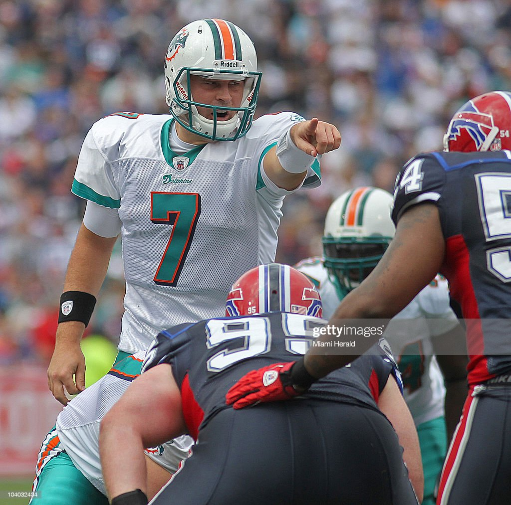 Miami Dolphins quarterback Chad Henne points to the defense in the first quarter of an NFL game against the Buffalo Bills at Ralph Wilson Stadium in Buffalo, New York on Sunday, September 12, 2010.