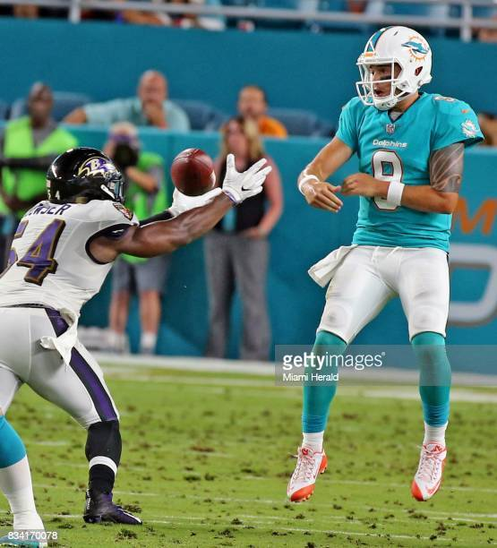 Miami Dolphins quarterback David Fales watches as Baltimore Ravens linebacker Tyus Bowser reaches for a deflected pass in the second qaurter in a...