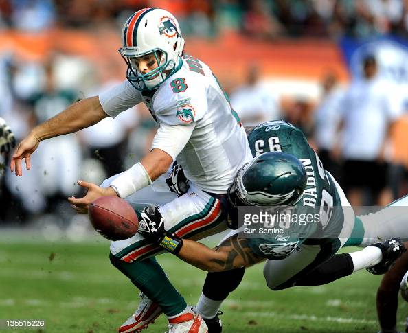 Miami Dolphins quarterback Matt Moore fumbles the ball as he is hit by Philadelphia Eagles defensive end Jason Babin at Sun Life Stadium in Miami...