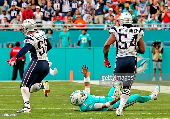 Miami Dolphins quarterback Matt Moore lays on the field after failing to stop the New England Patriots' Shea McClellin as he returns a fumble in the...