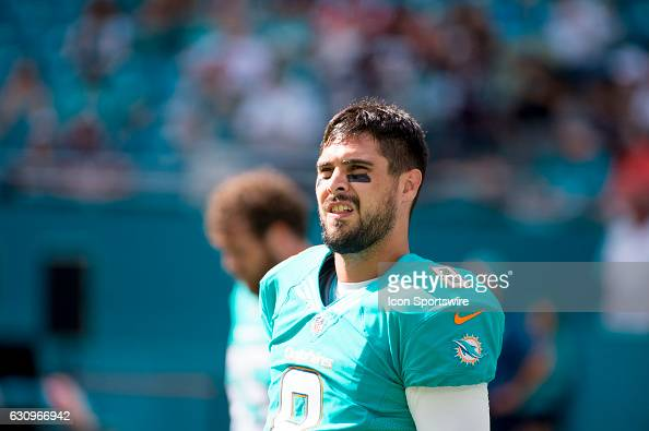 Miami Dolphins Quarterback Matt Moore warms up on the field before the start of the NFL football game between the New England Patriots and the Miami...