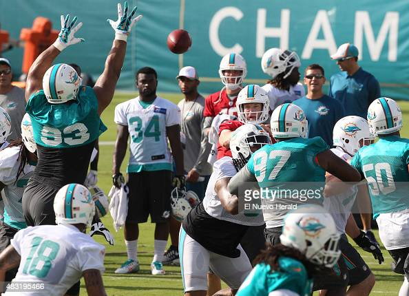 Miami Dolphins quarterback Ryan Tannehill throws during practice at the team's training camp in Davie Fla on Thursday Aug 6 2015