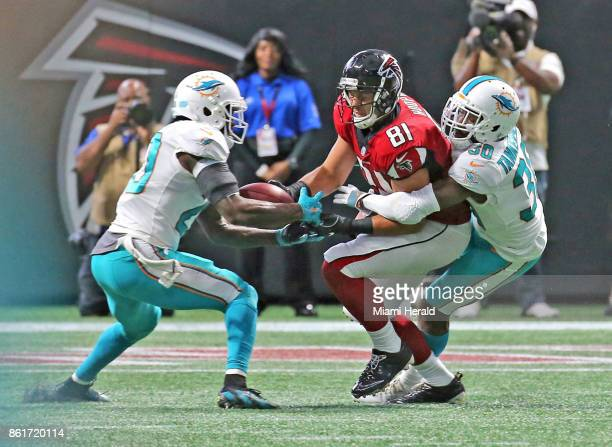 Miami Dolphins' Rashad Jones intercepts the ball from Atlanta Falcons' Austin Hooper with help from Cordrea Tankersley late in the fourth quarter on...