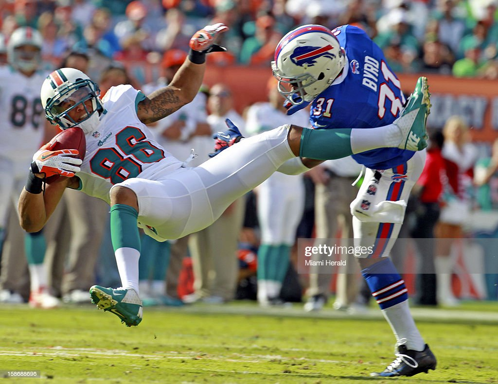 Miami Dolphin's Richard Mathews catches a second-quarter pass as Buffalo Bill's Jarius Byrd fails to defend at Sun Life Stadium on Sunday, December 23, 2012, in Miami Gardens, Florida. The Miami Dolphins defeated the Buffalo Bills, 24-10.