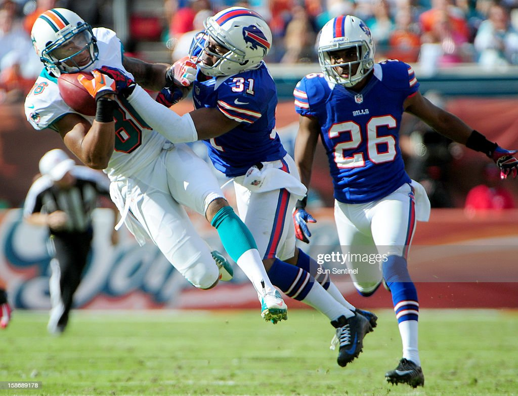 Miami Dolphins Rishard Matthews makes a catch for a first down over the defense of Buffalo Bills Jaurius Byrd during the second quarter at Sun Life Stadium on Sunday, December 23, 2012, in Miami Gardens, Florida. The Miami Dolphins defeated the Buffalo Bills, 24-10.