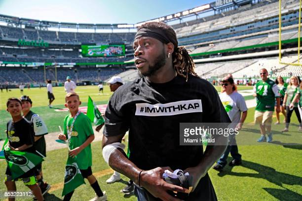 Miami Dolphins running back Jay Ajayi and several other Dolphin players wear Tshirts supporting Colin Kaepernick during warmups against the New York...