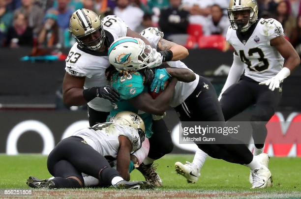 Miami Dolphins running back Jay Ajayi gets tackled by 3 New Orleans Saints players during the NFL match between the Miami Dolphins and the New...