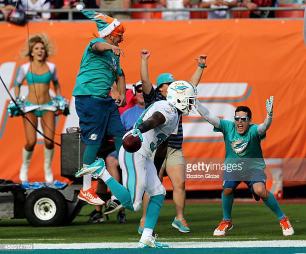 Miami Dolphins running back Marcus Thigpen brought the Dolphins fans to their feet after scoring a 14yard reception for a touchdown in the fourth...