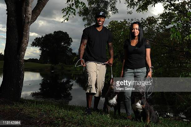 Miami Dolphins wide receiver Brandon Marshall and his wife Michi NogamiMarshall pose for photos with their dogs outside their home on May 17 2010 in...