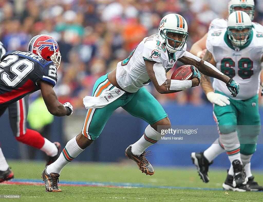 Miami Dolphins wide receiver Brandon Marshall runs for yardage against Buffalo Bills Drayton Florence in the second quarter at Ralph Wilson Stadium in Buffalo, New York on Sunday, September 12, 2010.
