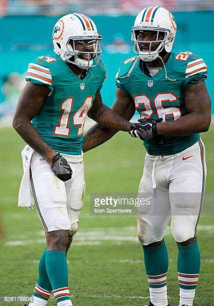 Miami Dolphins Wide Receiver Jarvis Landry limps off the field in pain assisted by Miami Dolphins Running Back Damien Williams during the NFL...