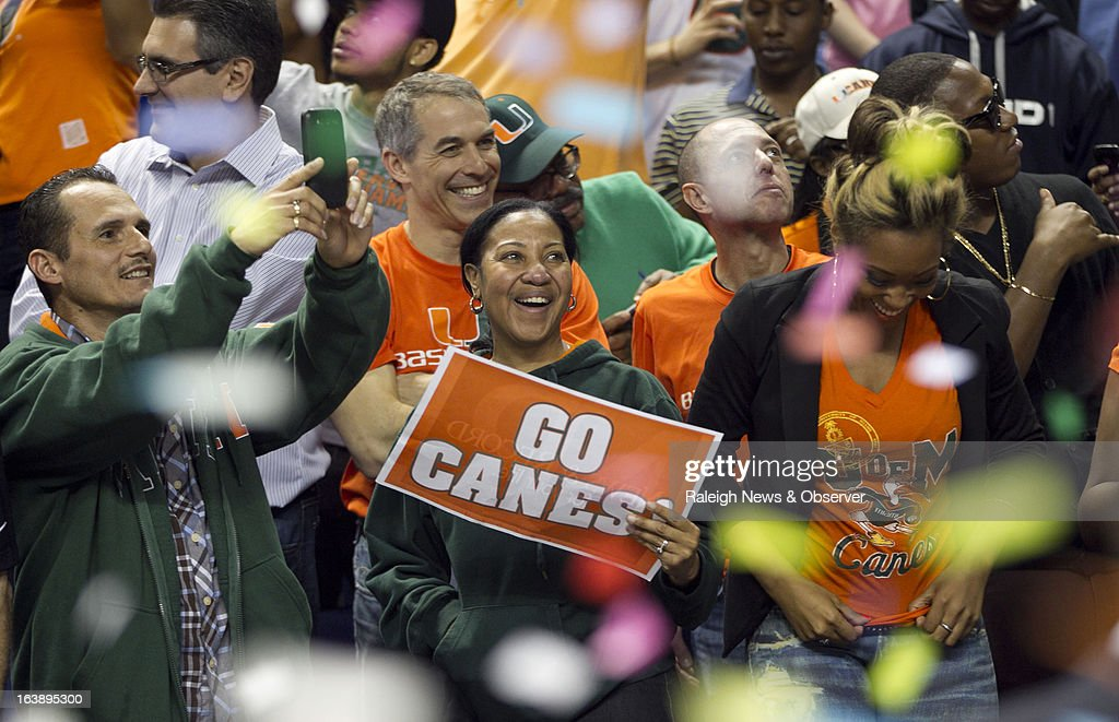 Miami fans celebrate the Hurricanes' 87-77 victory over North Carolina in the finals of the men's ACC basketball tournament at the Greensboro Coliseum in Greensboro, North Carolina, Sunday, March 17, 2013.
