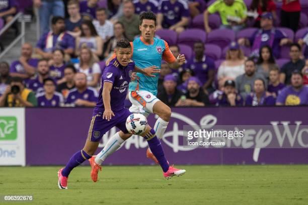 Miami FC midfielder Robert Baggio Kcira and Orlando City SC forward Pierre da Silva go after the ball during the Open Cup soccer match between Miami...