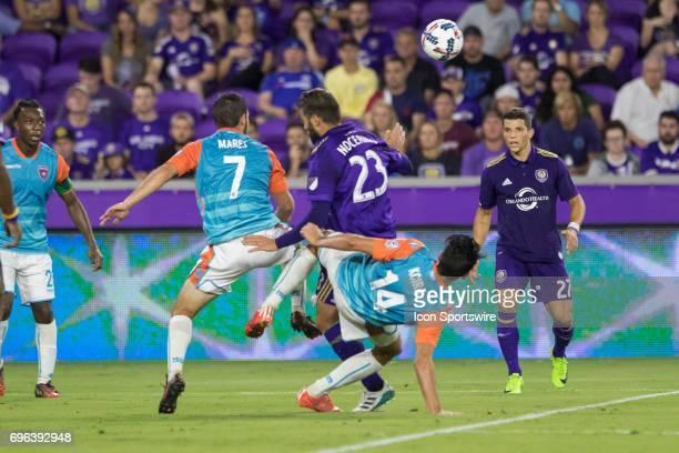Miami FC midfielder Robert Baggio Kcira Miami FC midfielder Dylan Mares and Miami FC midfielder Blake Smith collide while going for the ball during...