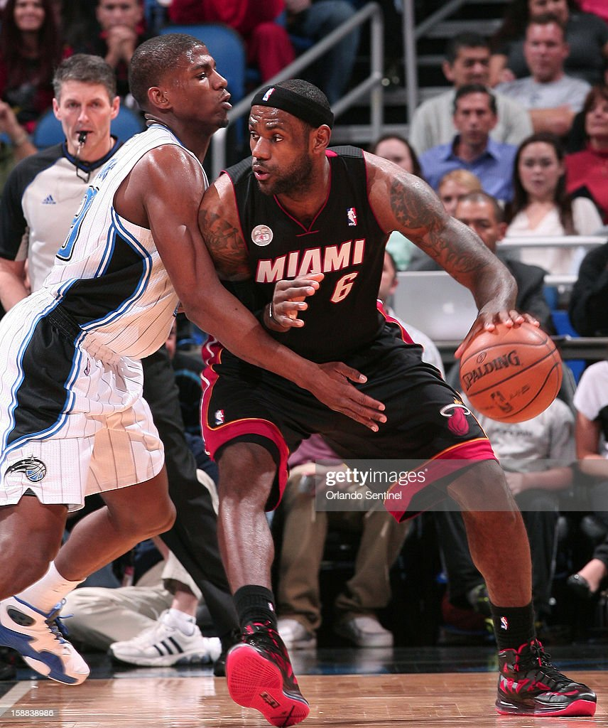 Miami forward LeBron James (6) posts up against Orlando forward DeQuan Jones (20) during the first half of the Magic's game against the Miami Heat in Orlando, Florida on Monday, December 31, 2012.