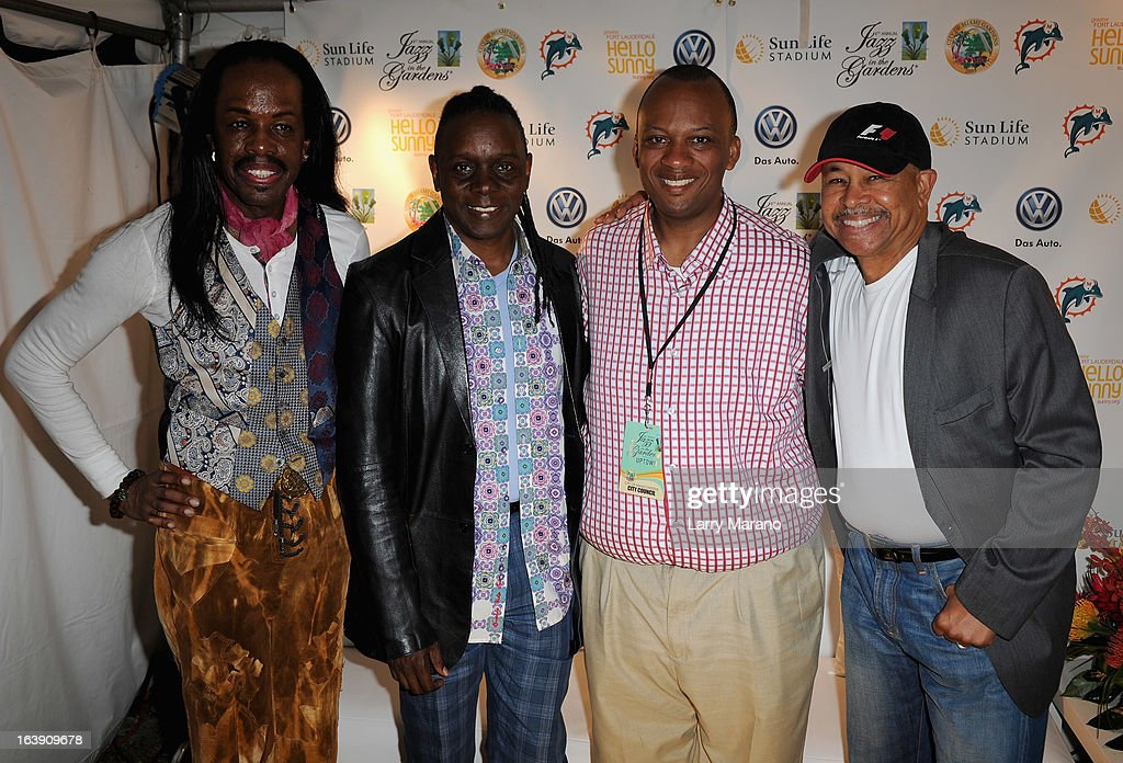 Miami Gardens Mayor Oliver G. Gilbert III (2nd R) poses with Earth, Wind & Fire members (L-R) <a gi-track='captionPersonalityLinkClicked' href=/galleries/search?phrase=Verdine+White&family=editorial&specificpeople=211265 ng-click='$event.stopPropagation()'>Verdine White</a>, <a gi-track='captionPersonalityLinkClicked' href=/galleries/search?phrase=Philip+Bailey&family=editorial&specificpeople=217868 ng-click='$event.stopPropagation()'>Philip Bailey</a> and <a gi-track='captionPersonalityLinkClicked' href=/galleries/search?phrase=Ralph+Johnson+-+M%C3%BAsico&family=editorial&specificpeople=12864218 ng-click='$event.stopPropagation()'>Ralph Johnson</a> backstage at the 8th Annual Jazz in the Gardens Day 2 at Sun Life Stadium presented by the City of Miami Gardens on March 17, 2013 in Miami Gardens, Florida.