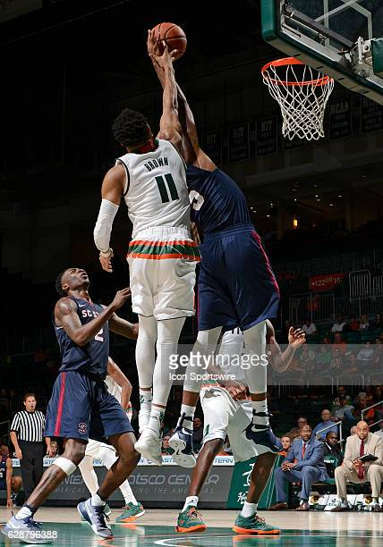 Miami guard Bruce Brown defends the shot of South Carolina State forward Ozante Fields during an NCAA basketball game between the South Carolina...