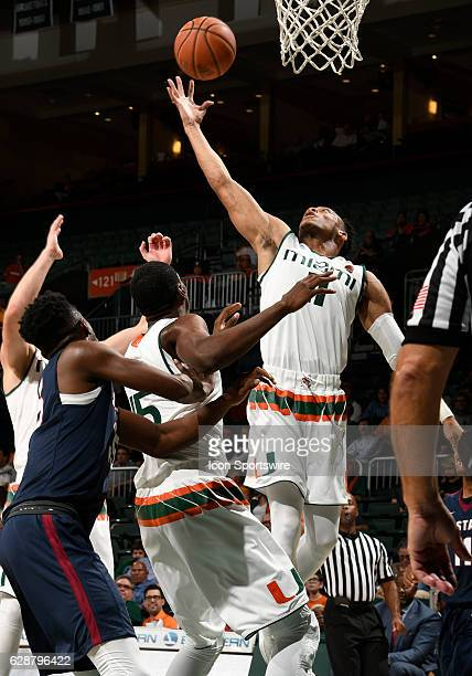 Miami guard Bruce Brown grabs a rebound during an NCAA basketball game between the South Carolina State Bulldogs and the University of Miami...