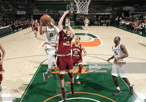 Miami guard Bruce Brown shoots against Boston College forward Nik Popovic during an NCAA basketball game between the Boston College Eagles and the...