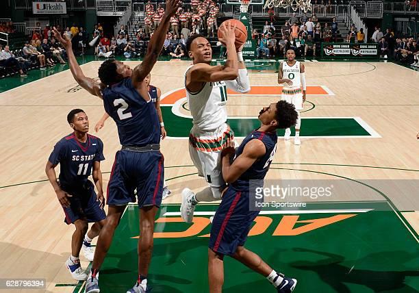 Miami guard Bruce Brown shoots against South Carolina State forward Ian Kinard during an NCAA basketball game between the South Carolina State...
