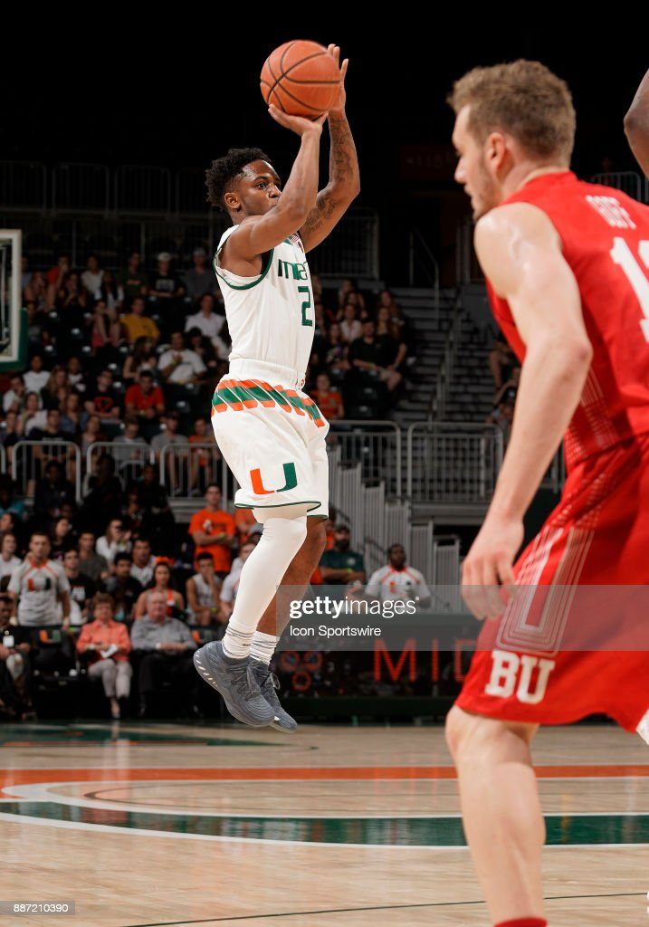 Miami guard Chris Lykes (2) shoots during a college basketball game between the Boston University Terriers and the University of Miami Hurricanes on December 5, 2017 at the Watsco Center, Coral Gables, Florida. Miami defeated Boston U