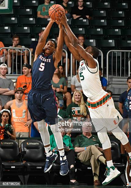 Miami guard Davon Reed and South Carolina State forward Ozante Fields reach for a rebound during an NCAA basketball game between the South Carolina...