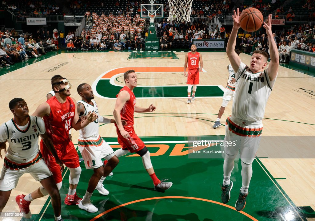 Miami guard Dejan Vasiljevic (1) rebounds during a college basketball game between the Boston University Terriers and the University of Miami Hurricanes on December 5, 2017 at the Watsco Center, Coral Gables, Florida. Miami defeated Boston U