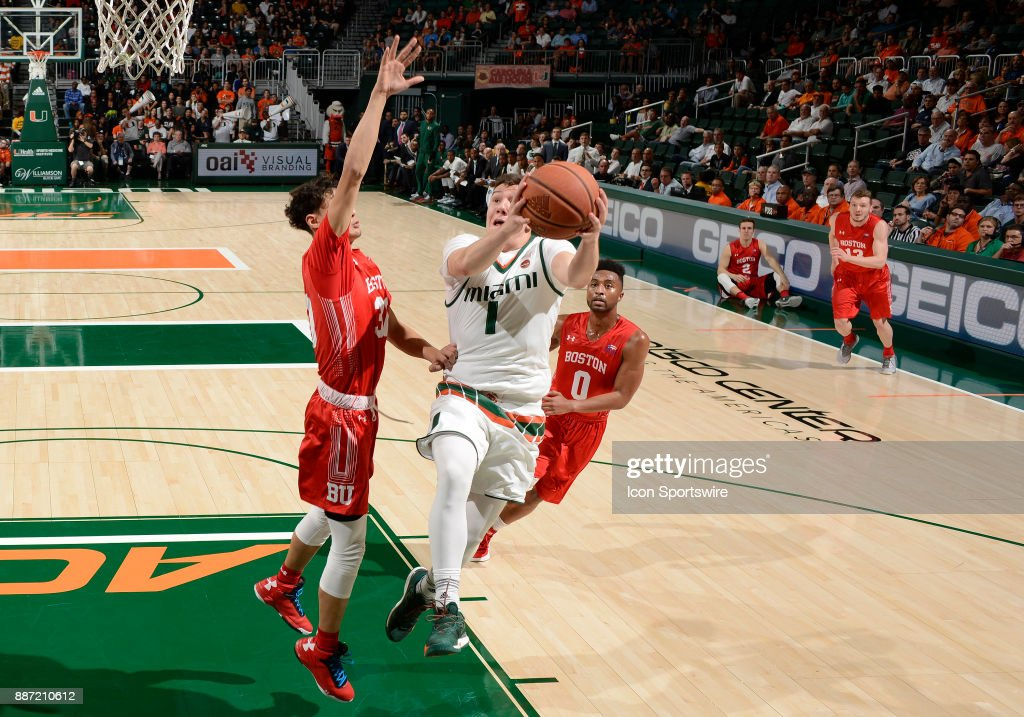 Miami guard Dejan Vasiljevic (1) shoots against Boston U guard Javante McCoy (30) during a college basketball game between the Boston University Terriers and the University of Miami Hurricanes on December 5, 2017 at the Watsco Center, Coral Gables, Florida. Miami defeated Boston U