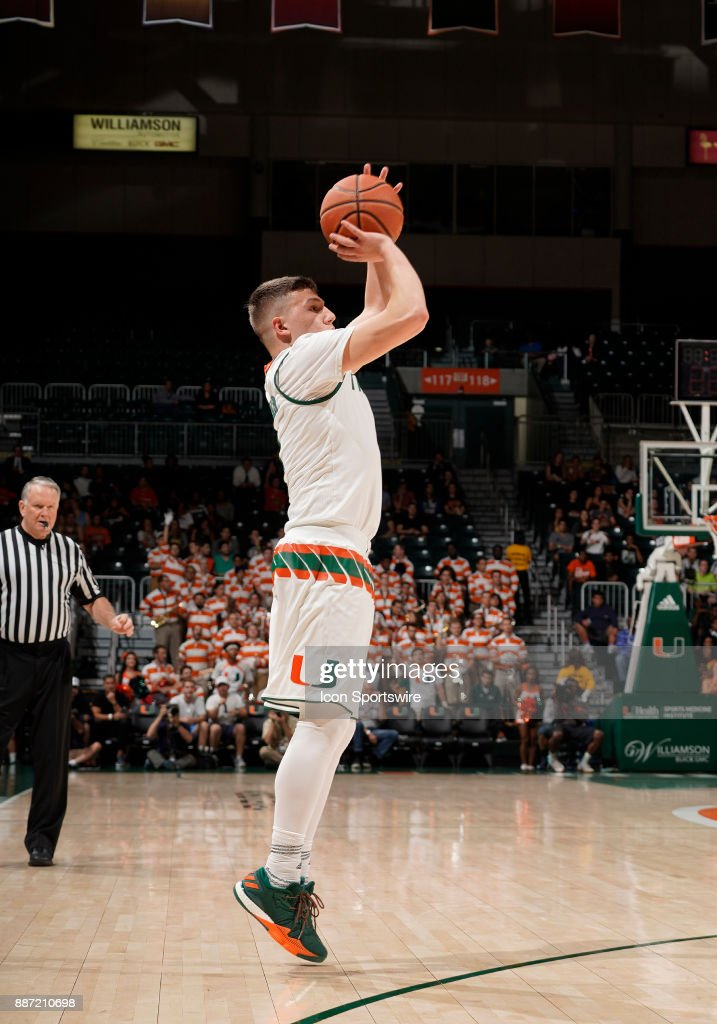 Miami guard Dejan Vasiljevic (1) shoots during a college basketball game between the Boston University Terriers and the University of Miami Hurricanes on December 5, 2017 at the Watsco Center, Coral Gables, Florida. Miami defeated Boston U